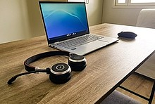 Laptop, mouse and headphones ready to be used for an online event